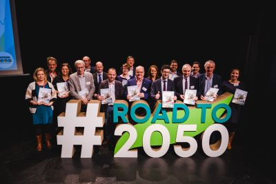 The key stakeholders pose with the Roadmap at our Road to 2050 conference. Credit: S. Vander Borght